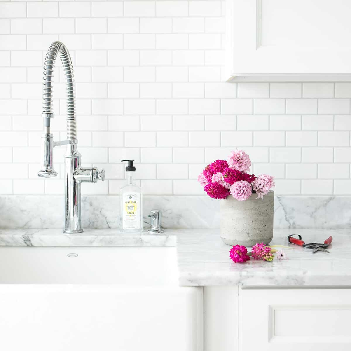 pretty subway tile backsplash with marble countertops